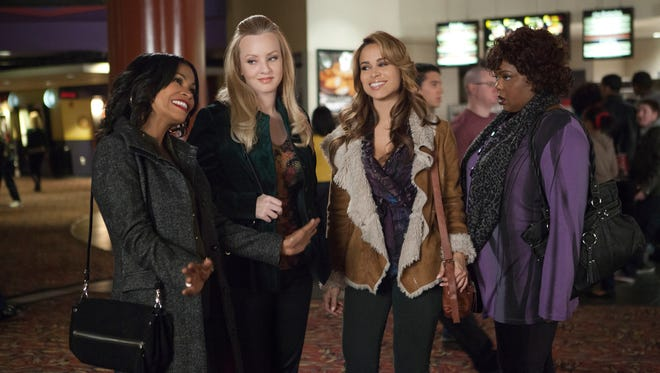 """Nia Long, left, Wendi McLendon-Covey, Zulay Henao, and Cocoa Brown in a scene from the motion picture """"The Single Moms Club."""""""