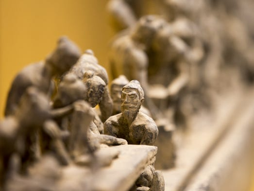 Clay figurines, depicting the citizens who built China's Terrecotta Army, are part of the display that is opening up at the end of the week, Indianapolis Children's Museum, Indianapolis, Monday, May 5, 2014.
