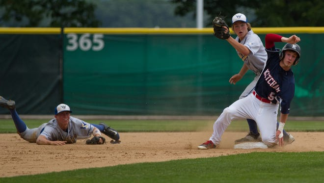 Webster Schroeder second baseman Zach Jenkins shows the ball after taking a flip from shortstop Justin Graham on a close play with Luke Tebolt in the state Class AA semifinal in Binghamton.