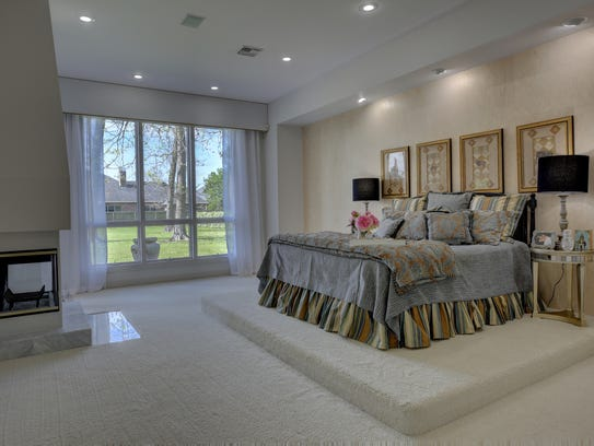 The luxurious master suite features enormous closets.