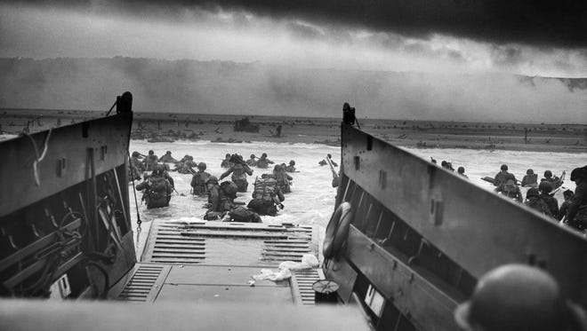 Soldiers from the 1st Infantry Division, 'The Big Red One,' wade ashore at Omaha beach on the morning of June 6, 1944. Today marks the 72nd anniversary of the largest amphibious landing in history.
