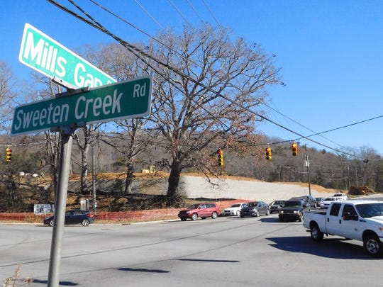 Traffic headed northeast on Mills Gap Road enters the intersection with Sweeten Creek Road in Skyland. Duke Energy work will close parts of Sweeten Creek in the South Asheville area starting Aug. 10.