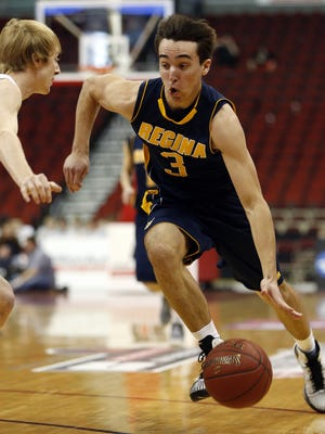 Nathan Stenger of Regina drives to the basket in the semifinal Class 2-A state tournament matchup with Pella Christian Thursday, March 12, 2015.