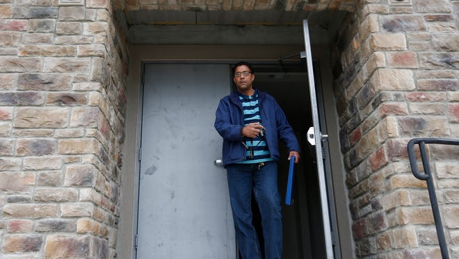 Spring Valley building inspector Walter Booker exits through a door at the Park View Condominiums at 120 N. Main Street in Spring Valley on Thursday, June 16, 2016.