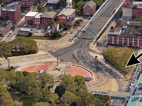 The Delaware River Port Authority will erect a 9/11 memorial on a triangular  property at the Philadelphia approach to the Ben Franklin Bridge on Race Street between 5th and  6th streets. Ben Franklin's lightning bolt  statue is in the center circle