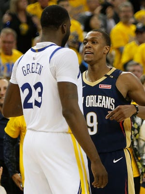 Draymond Green of the Golden State Warriors and Rajon Rondo of the New Orleans Pelicans exchange words during Game 1.
