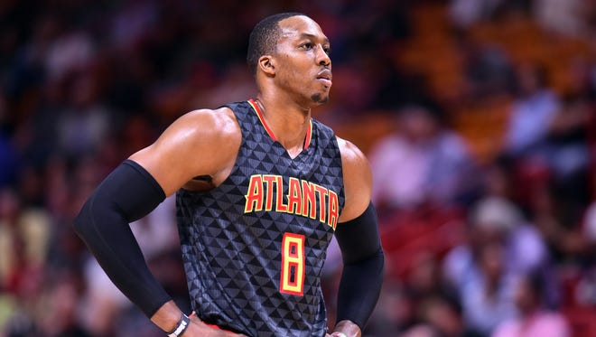 Atlanta Hawks center Dwight Howard (8) looks on from the court during the first half against the Miami Heat at American Airlines Arena.