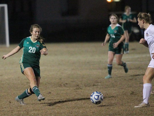 Lincoln's Katherine Whichel plays a ball forward as Leon defeated Lincoln 2-0 last year in a District 2-4A girls soccer championship.