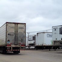 """A truck enters the """"staging"""" lot that JBS pork plant owns and leases at 151 and 201 Cabel Street in Butchertown."""