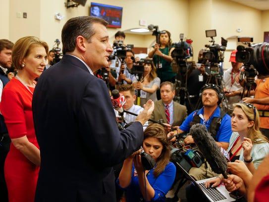 Ted Cruz, accompanied by Carly Fiorina, speaks to reporters