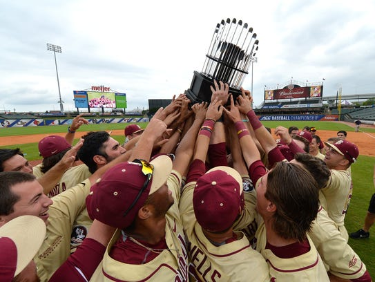 Florida State players hold up the trophy following