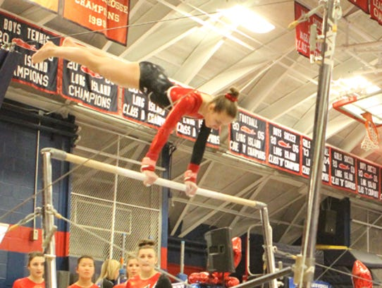 Jamison Castrataro on the uneven bars at last year's