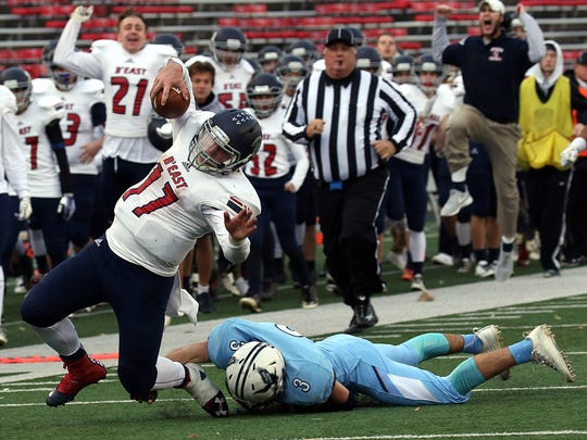 Jake Graf gets tackled after getting a first down on a third and 20 during the WIAA Division 2 State Football Championships against Monona Grove.