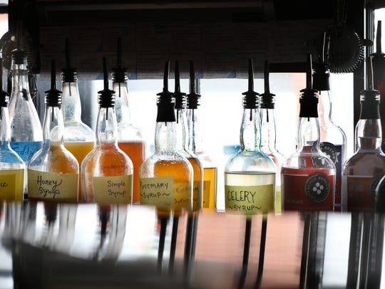 Syrups behind the bar at Black Button Distilling.