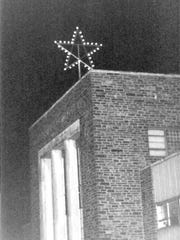 The Doubleday star sits on top of the Doubleday Book Company on Ridge Avenue. It was taken down in 2014 and is now in William Day's family.