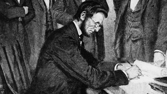 President Abraham Lincoln signs the Emancipation Proclamation on Jan. 1, 1863.