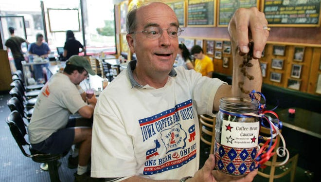 Dave Panther, owner of Hamburg Inn No. 2 in Iowa City, drops coffee beans into the jar he uses for the coffee bean caucus. Customers can put a bean into their preferred presidential candidate's jar. The restaurant has attracted many politicians, including Ronald Reagan in 1992.