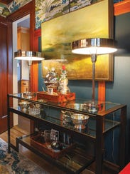 The bar/buffet lamps are by Thomas O'Brien.