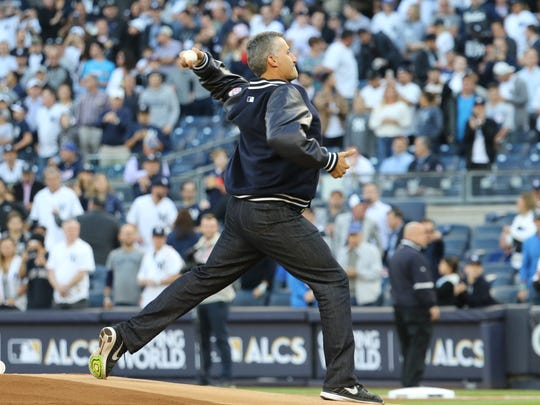 Former Yankee, Andy Pettitte, throws out the ceremonial first pitch to start Game 5, Wednesday, October 18, 2017.