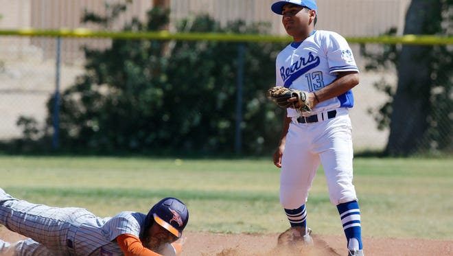 An unidentified Eastlake player gets a mouth full of dirt as he just makes it back safely to second base during action in the playoff game Saturday morning at Bowie as Bears shortstop J. Gaytan attempts to make the play. Eastlake went on to defeat Bowie 16-5 and advance to the next round of playoffs.