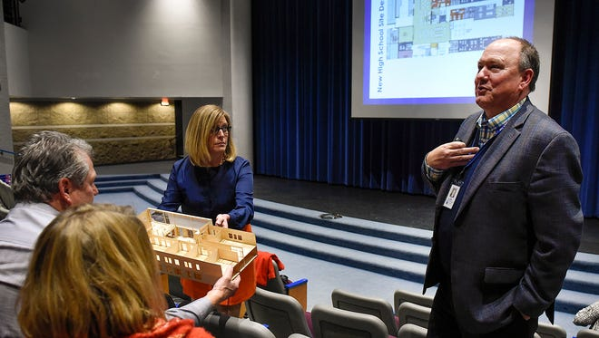 """Sartell-St. Stephen Assistant Superintendent Kay Nelson, left, shows a model of a """"learning neighborhood"""" wing as Superintendent Jeff Schwiebert describes the layout and features of the new high school Wednesday, Nov. 30, in Sartell."""