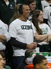 Former baseball star Alex Rodriguez watches from the
