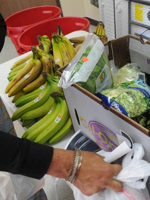 People select food at a Salvation Army food pantry  in Oxnard.