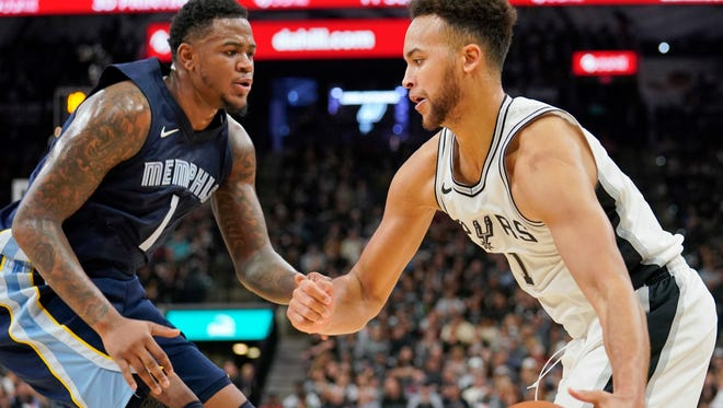 San Antonio Spurs forward Kyle Anderson, right, drives against Memphis Grizzlies forward Jarell Martin during the second half of an NBA basketball game, Wednesday, Nov. 29, 2017, in San Antonio. San Antonio won 104-95. (AP Photo/Darren Abate)