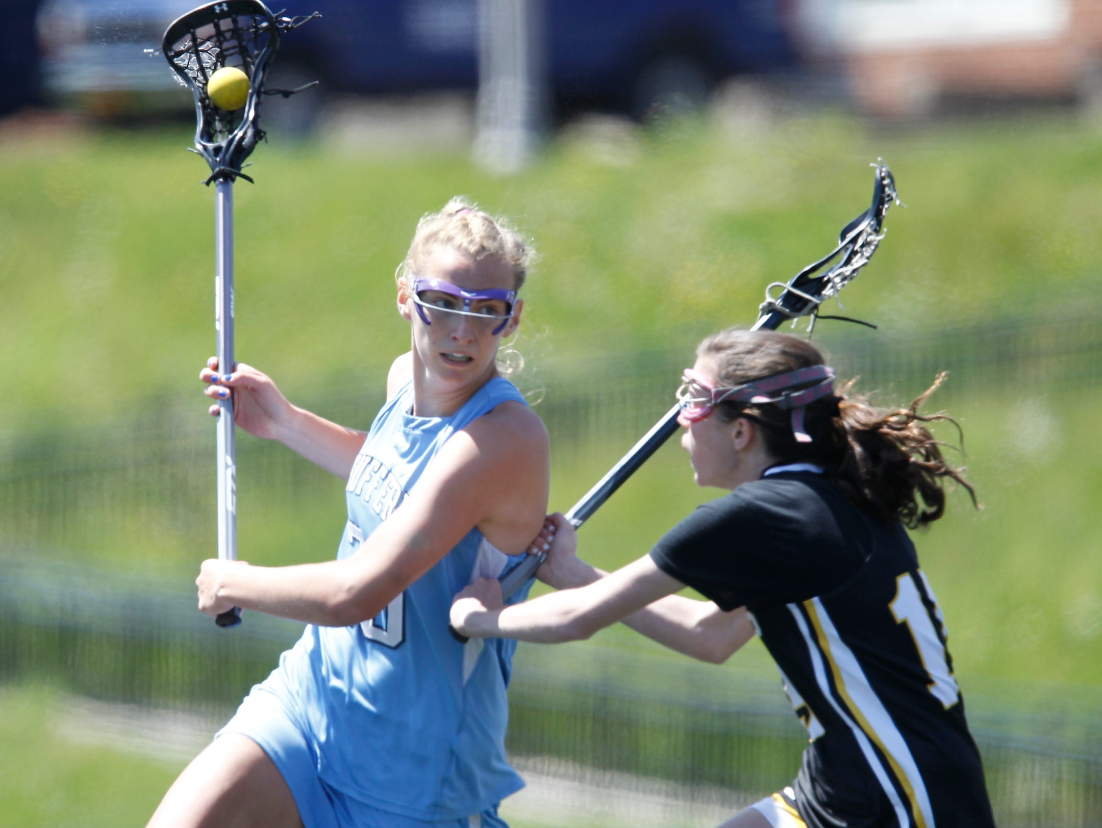 Suffern's Elizabeth Trojan (20) cradles the ball during a girls lacrosse game against St. Anthony's at Suffern Middle School in Suffern on Saturday, April 30, 2016. Suffern won 8-7.