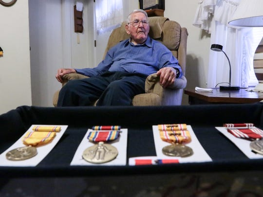 Gerald Cleveland, a World War II U.S. Army veteran who survived the Pearl Harbor attack in 1941, sits in his Anderson home near medals he recently received.