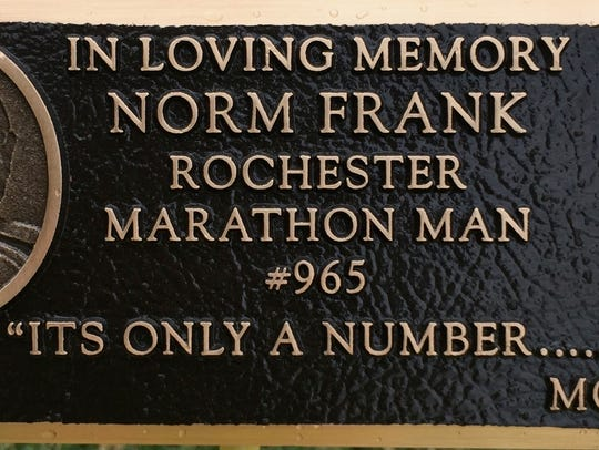 The plaque on a bench in Cobb's Hill Park dedicated