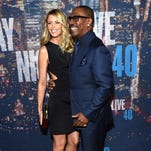 Paige Butcher (L) and Eddie Murphy attend SNL 40th Anniversary Celebration at Rockefeller Plaza on February 15, 2015 in New York City.