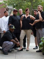 Jessica Ayala (center) and her husband Rob (standing center, with hat), seen here with the staff of Home 231, will open Revival Social Club in 2017 at the space formerly occupied by Otto's Kitchen and Cocktails in York.
