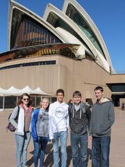 The team in Australia at the Sydney Opera house. Students from left to right are Cara Scalzo, Becky Ultzhoffer, Daniel Meza, Sam Turner, and Jacob Ultzhoffer