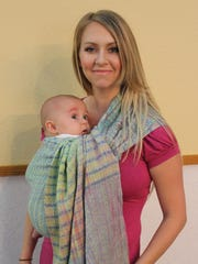 Jessica Scott uses a ring sling to carry son Euan.