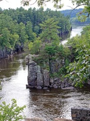 The St. Croix River cuts through a basalt gorge known as the Dalles of the St. Croix in St. Croix Falls. The dramatic rock walls are part of Interstate State Park — both on the Wisconsin and Minnesota sides of the river.