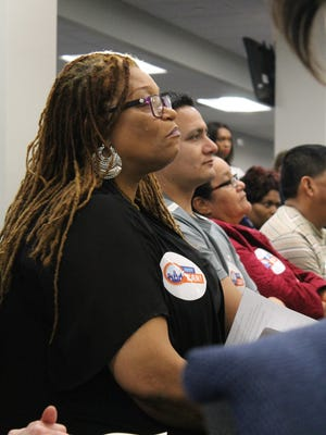 Doris Hill, of Indianapolis, listens to speakers at Thursday night's People's Hearing on Criminal Justice Reform. Hill said she was held in jail for two days after being arrested for a delinquent speeding ticket and couldn't afford to post bond.