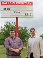 Former Halls Elementary School Principal, Chris Henderson, pictured left, shows new principal, Mitchell Cox, around the school grounds.