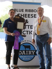 Ben Brancel passes out awards during the Blue Ribbon Cheese and Butter action at the Wisconsin State Fair prior to his retirement as secretary of Wisconsin Department of Agriculture, Trade and Consumer Protection.