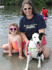 Stephanie and Isabelle Glaser and their rescue dog Bailey at the recent 'doggie paddle' charity event.