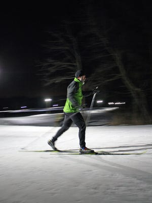A cross-country skier makes his way around the lighted loop at Lapham Peak.