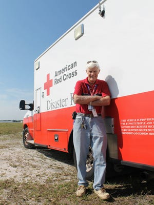 Robert 'Bob' Livingston with a Red Cross emergency response vehicle.