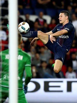 Paris Saint-Germain midfielder Julian Draxler controls the ball in front Guingamp goalkeeper Karl-Johan Johnsson during a match in Paris on April 9, 2017.
