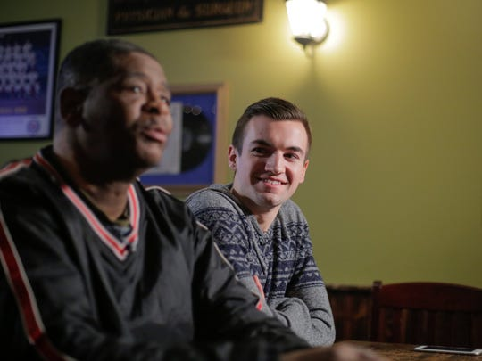 Evan Leedy, 19, of Macomb Twp. listens while James Robertson, 56, of Detroit, is recorded for CBS after meeting for the first time at Mr. B's Pub in Rochester on Monday, Feb. 2, 2015.