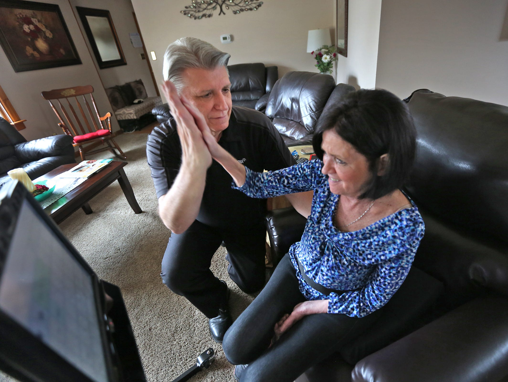 In March, Maureen Burakiewicz high-fived with her husband, Jim, when she successfully used a speech-generating table.