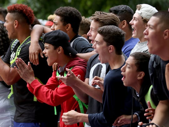Fans cheer during the Hoopla basketball tournament outside the Oregon State Capitol in Salem on Sunday, Aug. 7, 2016.