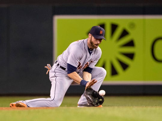 Sep 20, 2016; Minneapolis, MN, USA; Detroit Tigers second baseman Andrew Romine fields a ground ball in the fifth inning against the Minnesota Twins at Target Field.