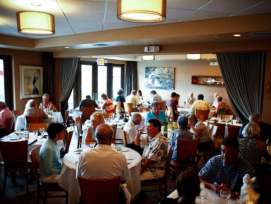 Patrons enjoy dinner in August 2013 at the Mangrove