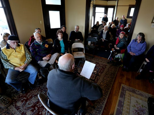Sid Halse, of Stayton, performs for a couple dozen people during a Folk Music Play-In at the Charles and Martha Brown House in Stayton on Sunday, March 5, 2017. Professional musicians and local amateurs performed together during the free event.