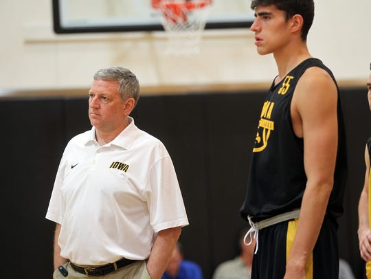 Iowa assistant coach Kirk Speraw works with incoming